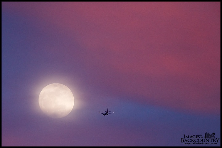 The Moon and an airplane over the Oasis Las Vegas RV Resort
