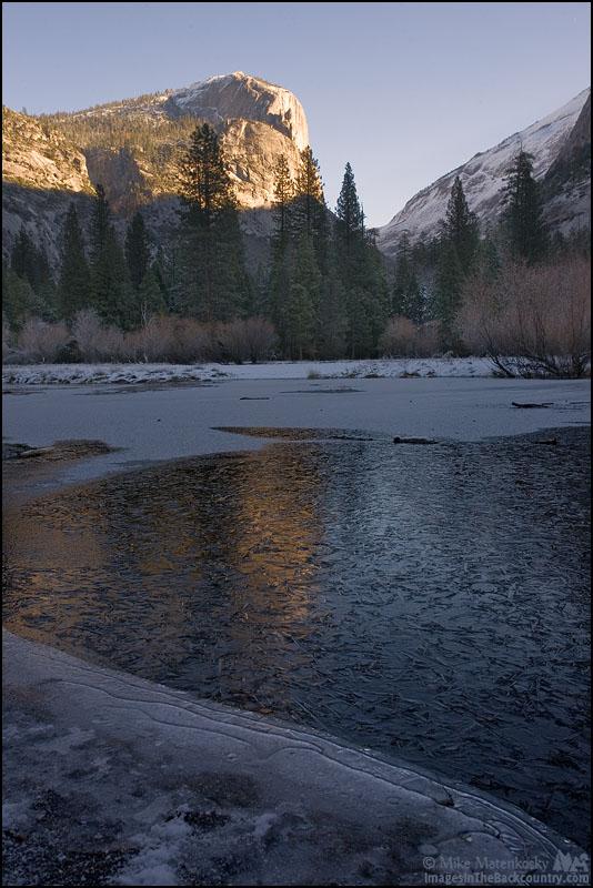 Mount Watkins reflecting a frozen Mirror Lake.