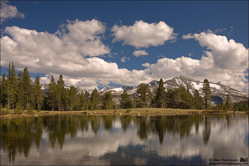 Photo of clouds and Mammoth Peak and the Kuna Crest
