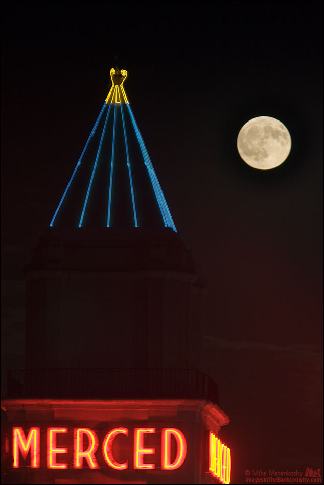 The Moon rising over the Merced Theatre in Merced California.